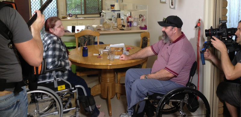 Rebecca and Luke talking and being filmed in Bundaberg Queensland by Screencraft for a film about disability advocacy.