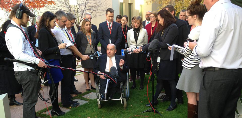 Craig Wallace describing the effects of the 2014 Budget on people with disability — at Parliament House, Canberra, 14 May 2014