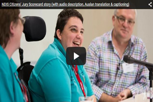 An image of Simone Stephens giving evidence to the NDIS Jury. Simone is an NDIS participant and was a focus group representative. There is a triangular shaped play button over the top of Simone's image, in the centre of the image. The button indicates if you click the link it will play a video of the short documentary about the Citizens' Jury Scorecard.