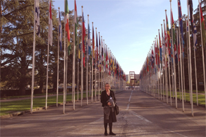 Therese Sands (Australian CRPD Civil Society Parallel Report Group representative) outside the UN building, Palais de Nations with the flags of all the member countries.