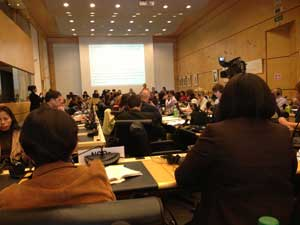 Photograph of the meeting inside a large room packed with people in Geneva