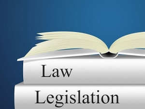 IMAGE: An open book sits on top of two other books titled Law and Legislation. Image courtesy of Stuart Miles at FreeDigitalPhotos.net